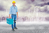 Composite image of full length portrait of repairman with toolbox
