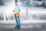 Composite image of smiling construction worker holding clipbard