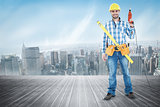 Composite image of portrait of smiling repairman with tools