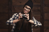 girl in glasses and braces with vintage camera