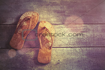Pair of beach sandals on wood