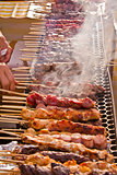 Street fair tend of skewered meat