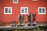 Cowboy Boots in Front of a Red Barn