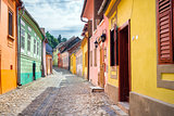 Stone paved old streets with colored houses from Sighisoara fort