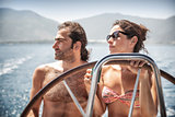 Beautiful couple on sailboat