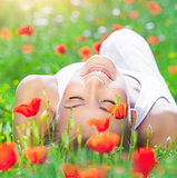 Relaxation on poppy flower field