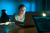 Woman Writing On Social Network With PC Late At Night