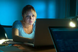 Woman Reading Scary Message On Social Network Late Night