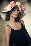 charming girl with flowers hat