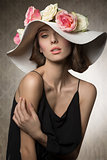 stunning girl with flowers on hat