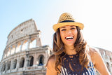 Happy woman tourist in Rome near Colosseum in summer