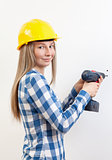 Woman doing the DIY work and wearing protective helmet