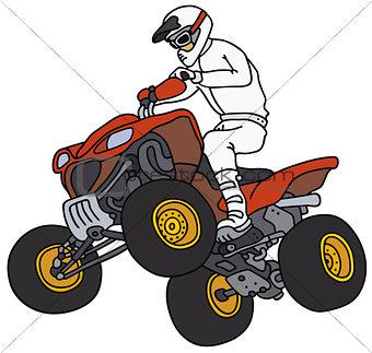 Rider on the red ATV