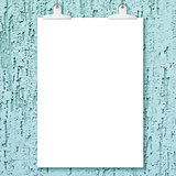 Blank white poster hanging on plaster monochrom wall background.