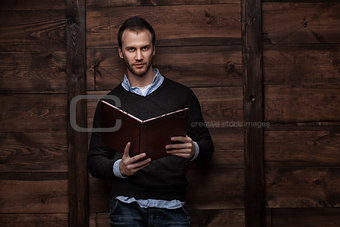 young handsome man with a book