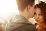 Sunny outdoor portrait of young happy couple