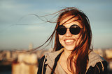 Young woman in round sunglasses having fun