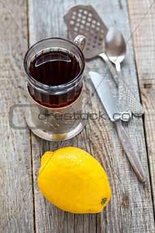 Black tea in glass and lemon.