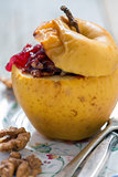 Baked apple with nuts and berries.