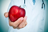 doctor wiht an apple, depicting the idea of the healthy eating