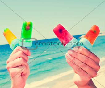 homemade ice pops on the beach, with a filter effect