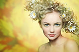 portrait of beautiful girl with flowers in their hair