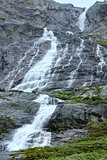 Waterfall in summer mountain