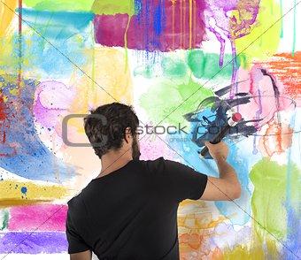 Boy colors a wall