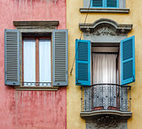Italian house with colorful walls, windows and balcony