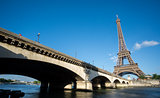 The Eiffel Tower and bridge over Seine River in Paris