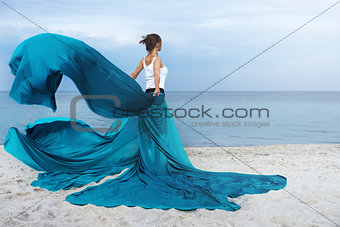 Beautiful Girl With  fabric on The Beach.