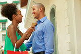 African American Couple Holding Credit Card In Panama