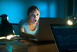 Woman Watching Shocking Message On Social Network Late Night
