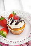 Delicious cream and strawberry cupcakes