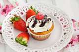 Delicious cream and strawberry cupcakes