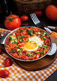Shakshuka with tomatoes and eggs