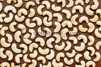cashew nuts on rustic wood