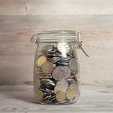 Coins in glass money jar
