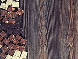 set of chocolates  on dark wooden table