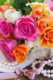 pink and orange roses with lace
