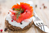 Sandwich with salted red salmon and black bread.
