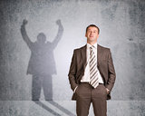 Businessman with shadow showing win