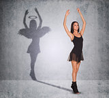Ballet dancer with shadow showing angel side