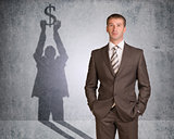 Businessman with shadow holding dollar sign