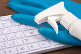 Airbrush with rubber gloves on keyboard