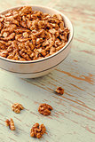Walnut Kernels in Bowl on Rustic Wooden Background