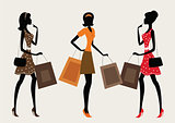 Three silhouettes of a women shopping.