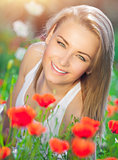 Beautiful woman on poppy field