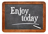 Enjoy today - text on blackboard