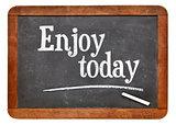 Enjoy today - text on blackboard